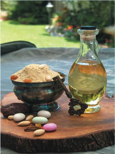 אבקת הבסיסה מוכנה, שמן,מפתח לבחישה והתוספות,דרג'ה, שקדים ותמרים